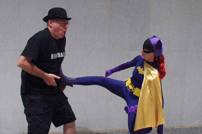 Batgirl and her henchman