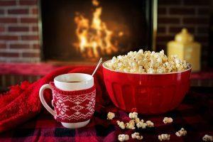 popcorn and mug by fire