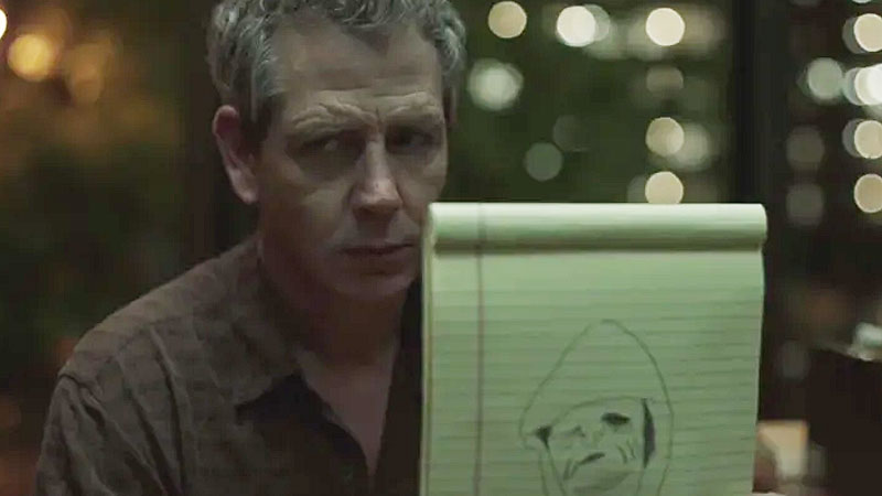 Ralph holding up monster drawing in The Outsider TV show.